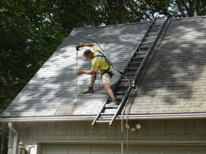 A beautiful home is being safely restored to its glory by Rob Point, the roof washing expert for Kevin Palmer Painting.