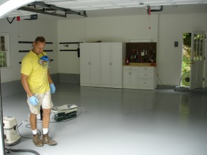 A durable epoxy floor paint was applied to the garage floor of this Farmington, CT home by the painting professionals of Kevin Palmer Painting. 