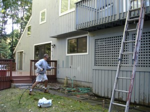 Power washing safely removes all mold, mildew, and surface contaminants before the house painting begins on this Avon, CT home.